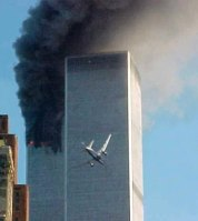 ** ADVANCE FOR MONDAY, SEPT. 8, AND THEREAFTER ** FILE ** In this Sept. 11, 2001 file photo, a  jet airliner is lined up on one of the World Trade Center towers in New York. President Bush said he didn't care how Osama bin Laden was brought to justice. Just get him. That was back in 2001, when Bush used bravado to lead the nation past the shock of the attacks on the World Trade Center, Pentagon and Pennsylvania.  (AP Photo/Carmen Taylor, File)